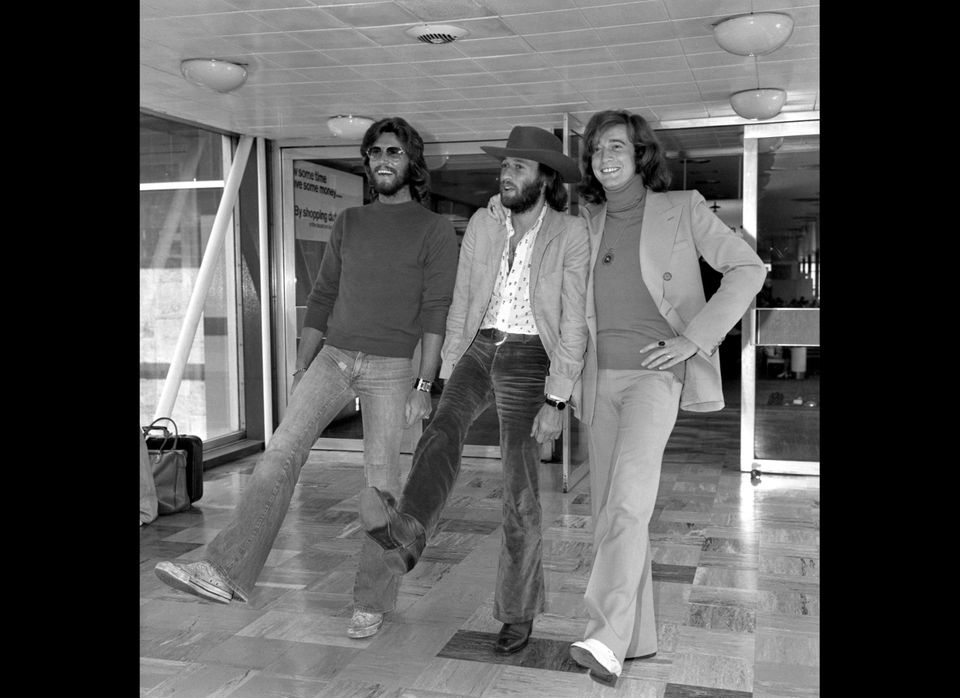 The Bee Gees (L-R) Barry, Maurice, Robin Gibb at Heathrow Airport, London, before leaving for a 3 month World Tour. 1974