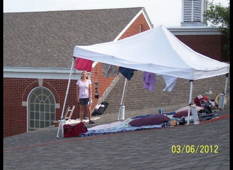 Robin Evans stands under her makeshift home, perched on the roof of First United Methodist Church in Texas. She's staying the