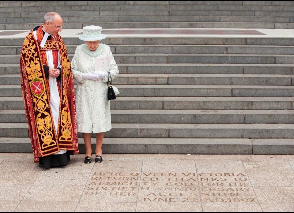 Britain's Queen Elizabeth II views an inscription dedicated to Queen Victoria at the foot of the steps of St Paul's Cathedral