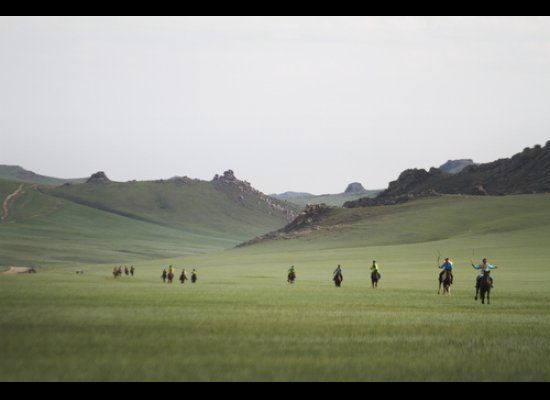Young jockeys race down the final stretch in a 22-kilometer race at the annual Naadam festival in Ugtaal, Mongolia.