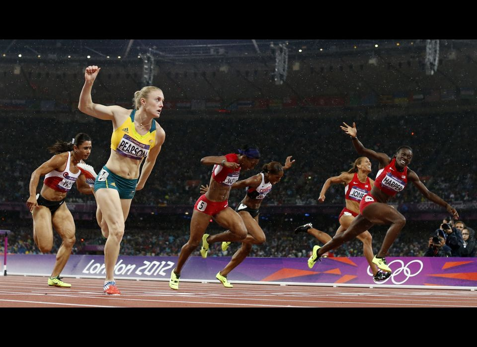 Australia's Sally Pearson, front left, crosses the finish line ahead of United States' Dawn Harper, right, to win gold in the