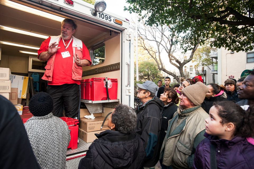 Mike Gilley, a Red Cross worker from Dothan, Ala., speaks to Hoboken, N.J. residents who were hit hard by flooding from Hurri