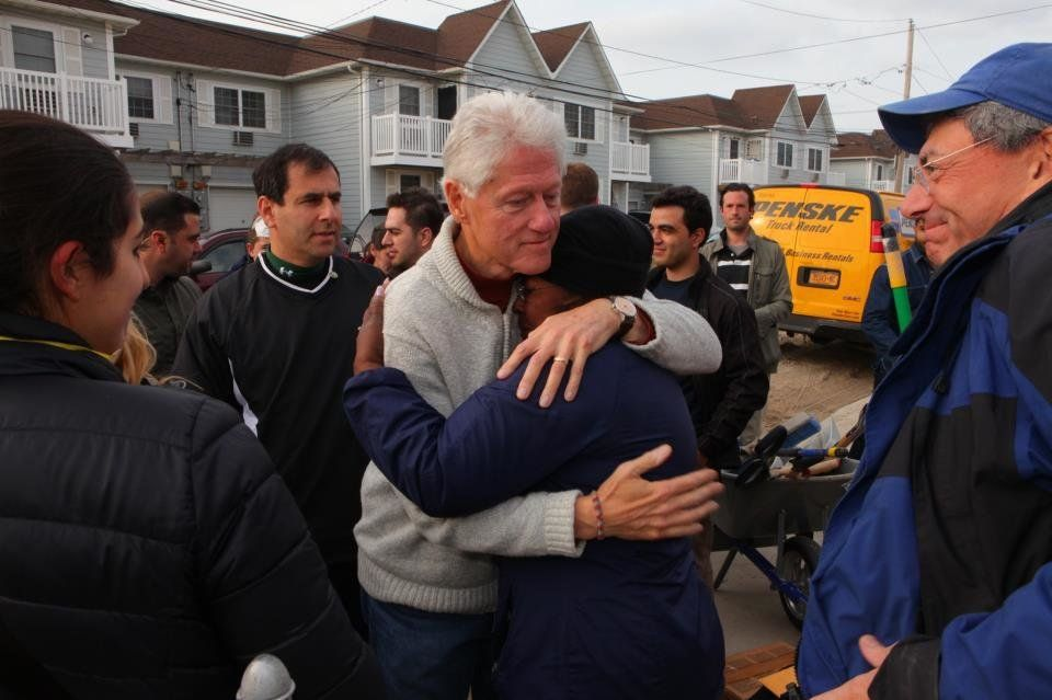Bill Clinton, along with 1,000 volunteers, volunteered with Sandy victims on the hard-hit region of the Rockaways on Sunday f