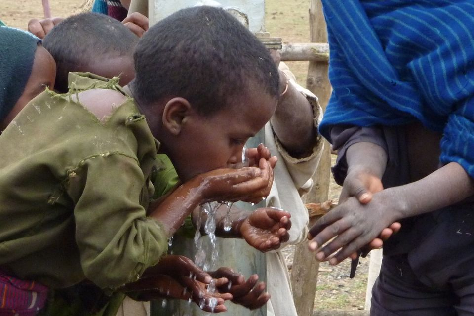Children drinking clean water from their new village well in Tigray, Ethiopia. Photo by Keith Stamm, courtesy of Water.org