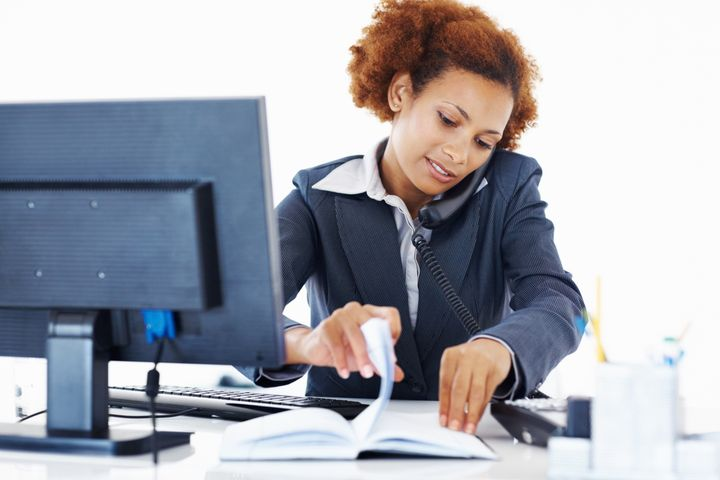Attractive African American woman busy at workplace