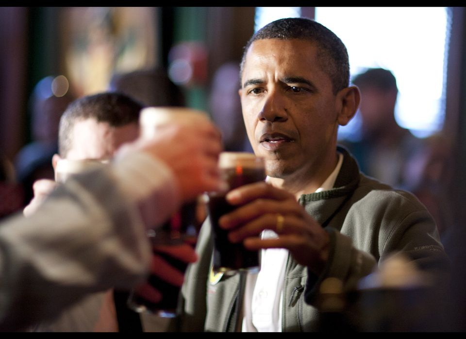WASHINGTON, DC - MARCH 17:  (AFP OUT) U.S. President Barack Obama toasts with Guinness beer as he visits a bar in celebration