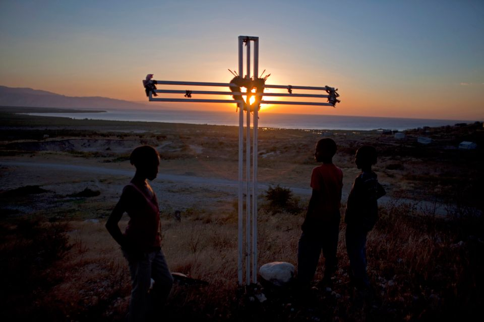 In this picture taken Jan. 8, 2013, a cross memorializing the victims of the 2010 earthquake who are buried at the spot in ma