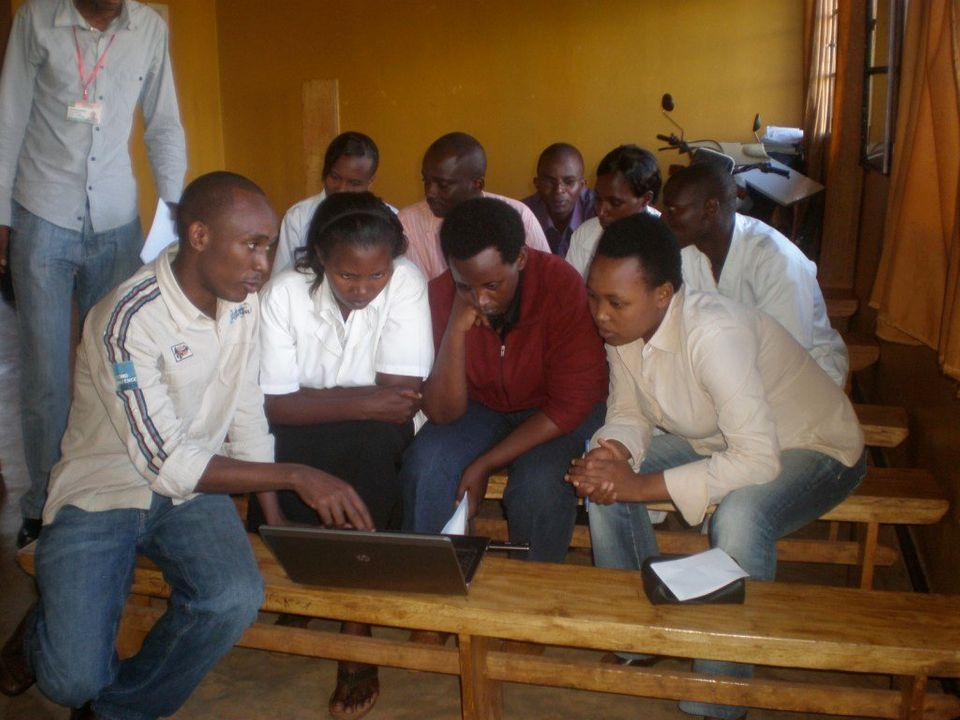 Evode Uwanyirigira, a District Health Fellow with the Access Project, leads a training in Rwanda.