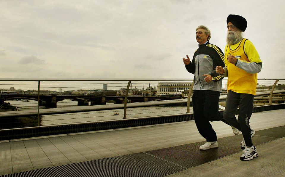LONDON, UNITED KINGDOM:  Ninty three-year-old Fauja Singh (R), the oldest runner in this year's Flora London marathon, runs o