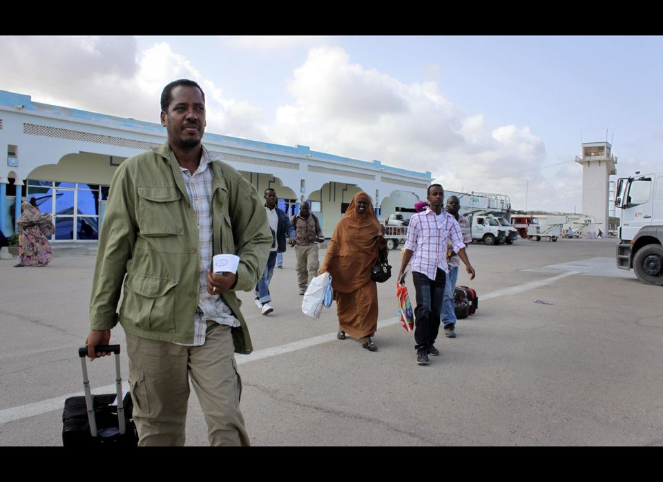In this photo taken Friday, June 8, 2012, Abdikhafar Abubakar prepares to board a plane back to Minneapolis after returning t