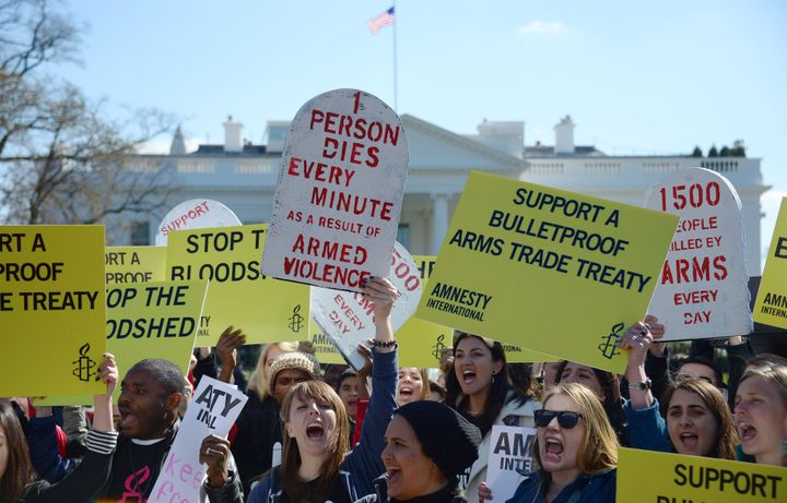 Demonstrators from Amnesty International chant outside the White House in Washington, DC, March 22, 2013, as they protest cal