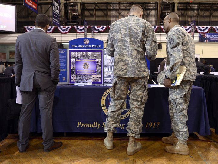 "Soldiers at the New York State Police booth  during the ""Hiring Our Heroes – New York,""  hiring fair for veterans and militar"