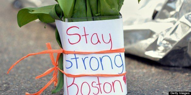 Flowers and a message are left on Newbury Street April 16, 2013 in Boston, Massachusetts, a few blocks from where two explosi