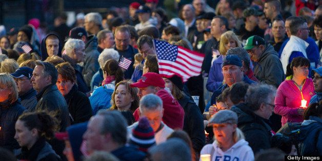 Mourners hold candles and U.S. flags during a vigil for Martin Richard, one of three killed in the Boston Marathon bombings,