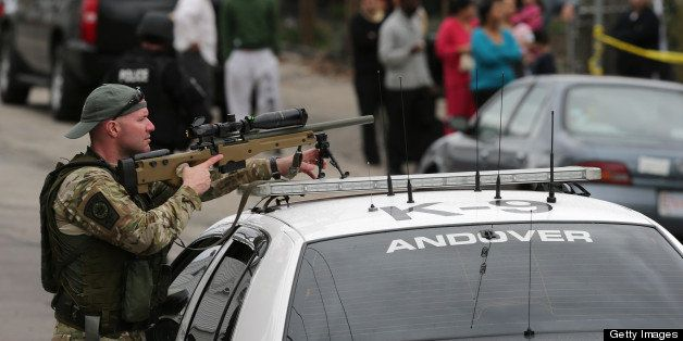 WATERTOWN, MA - APRIL 19: S.W.A.T. teams conduct a house to house search in an area near last night's shootout during the ong
