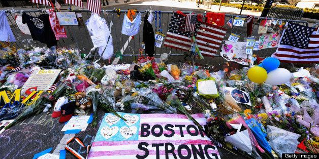 BOSTON, MA - APRIL 21: Items are placed by people visiting a makeshift memorial for victims near the site of the Boston Marat