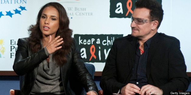 WASHINGTON, DC - DECEMBER 01: Alicia Keys and Bono speak during the 2011 World AIDS Day discussion at George Washington Unive