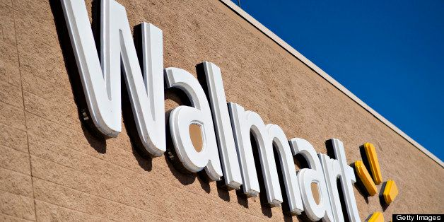 A sign hangs outside a Wal-Mart store in East Peoria, Illinois, U.S., on Wednesday, Feb. 20, 2013. Wal-Mart Stores Inc., the