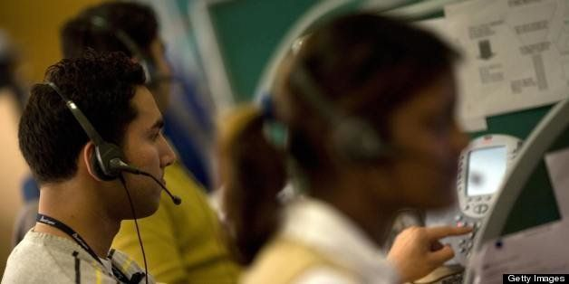 Indian workers answer telephone calls at a call-centre in Gurgaon on the outskirts of New Delhi on December 5, 2008.   Delhi,