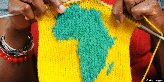 African woman knitting the shape of Africa.