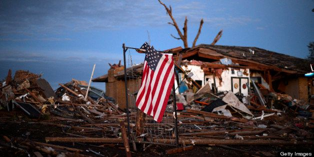 A US flag is seen amongst the debris of a torando devastated house on May 21, 2013 in Moore, Oklahoma. Families returned to a