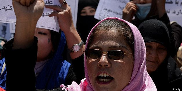 Afghan university students and independent civil society activists take part in a demonstration in support of passing the Eli