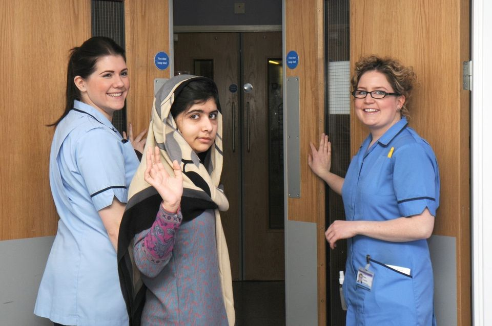 This photo made available by Queen Elizabeth Hospital, Birmingham, England shows Malala Yousufzai saying goodbye as she is di