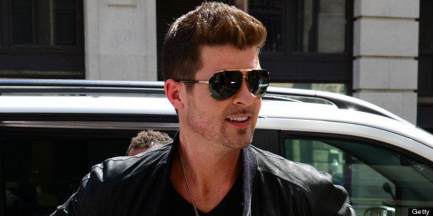 LONDON, UNITED KINGDOM - JULY 09: Robin Thicke sighted arriving at BBC Radio Two on July 9, 2013 in London, England. (Photo b