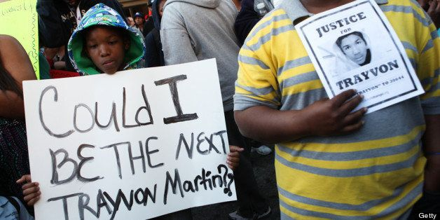 ATLANTA, GA - MARCH 26:  Jordan Miller, 10, holds a handmade sign alonside thousands of protesters rallying at the Georgia St