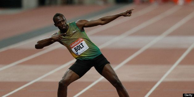 LONDON, ENGLAND - JULY 26:  Usain Bolt of Jamaica celebrates after crossing the line first in the Men's 100m A race on day on