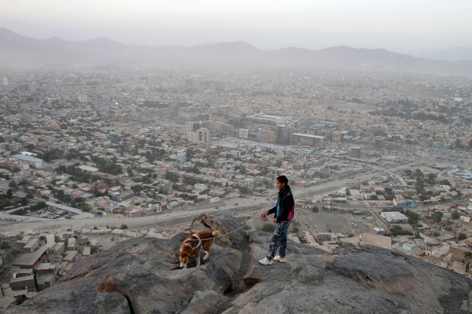 Afghan boy walks his dog on a hill above Kabul, Afghanistan, Monday, Oct. 1, 2012. (AP Photo/Ahmad Jamshid)