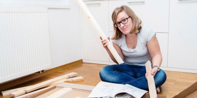 Furniture assembling. Woman trying to assemble table.