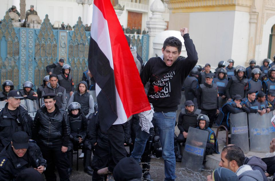 An Egyptian shouts slogans during anti-President Mohammed Morsi protest in front of the presidential palace in Cairo, Egypt,