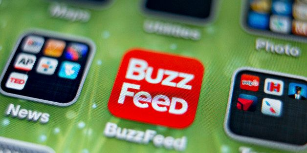 An icon for the BuzzFeed app is photographed on the home screen of an Apple Inc. iPhone 5 in Tiskilwa, Illinois, U.S., on Thu