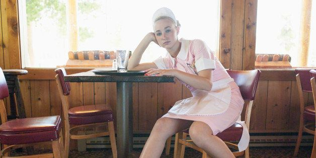 Waitress resting after work shift