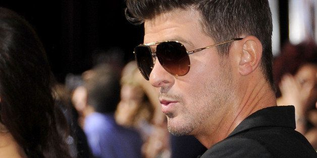 LOS ANGELES, CA - SEPTEMBER 25:  Singer Robin Thicke arrives at the Los Angeles premiere of 'Baggage Claim' at Regal Cinemas
