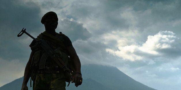 A soldier from the Democratic Republic of Congo regular army (FARDC) stands guard in Kibati near Goma, with the Nyiragongo Vo