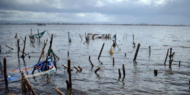 TACLOBAN, PHILIPPINES - NOVEMBER 14: A body of typhoon victim comes ashore in typhoon-ravaged Tacloban city on November 14, 2