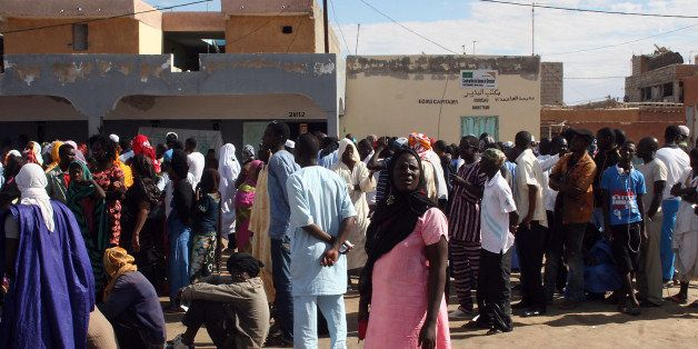 Residents queue up outside the Sebkha polling station in Nouakchott on November 23, 2013. Mauritanians voted Saturday in nati