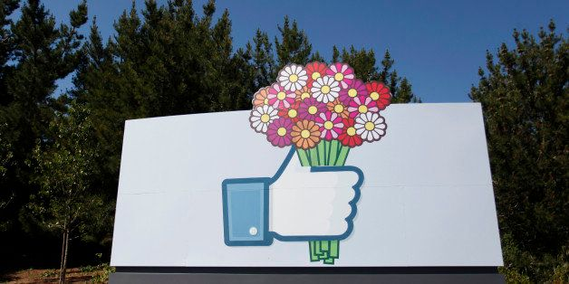 A Facebook 'like' button logo with flowers is seen at the entrance of the Facebook headquarters in Menlo Park, California, on