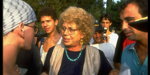 Controversial (left-leaning Meretz bloc), outspoken Min. of Education Shulamit Aloni (C) w. students on campus of Givat Haviv