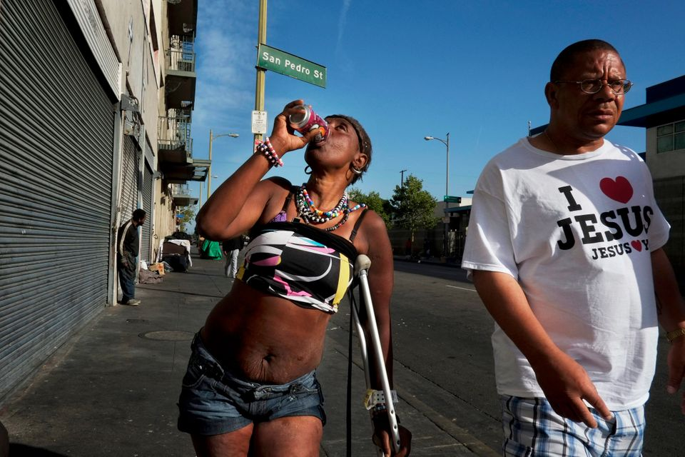 Antoinette Theus, 45, who says she has been homeless for 30 years, drinks a can of soda in the Skid Row area of Los Angeles,