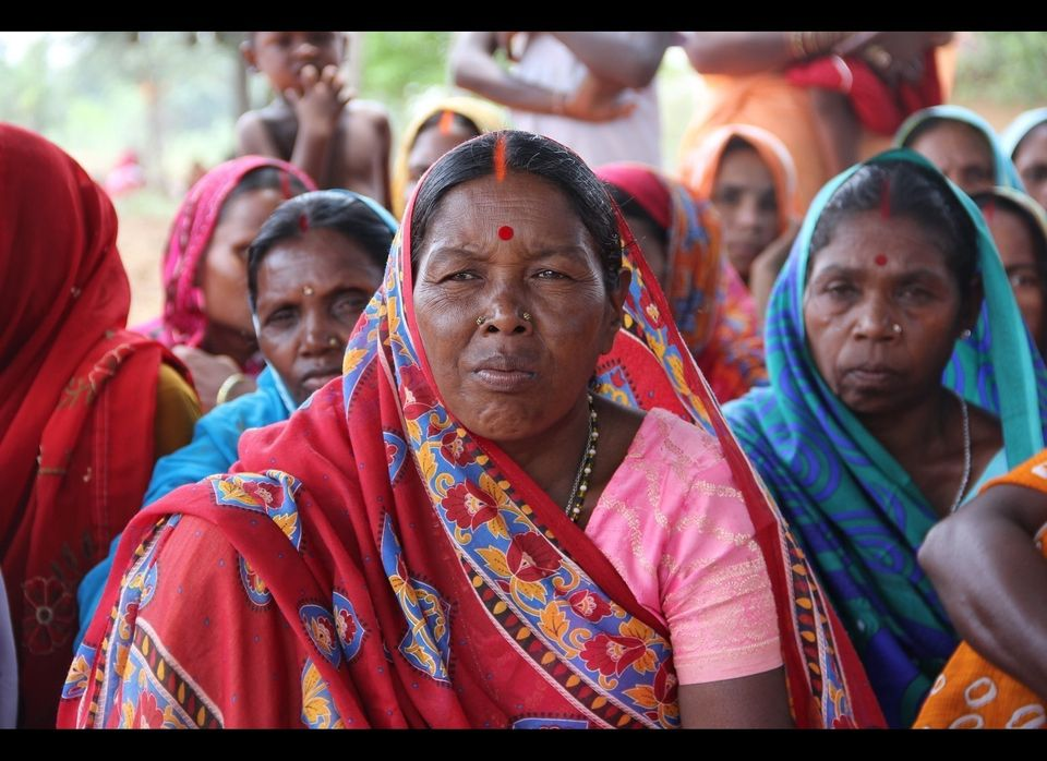 Women from several self-help groups gather to report on their most recent harvest and the progress of their self-help groups