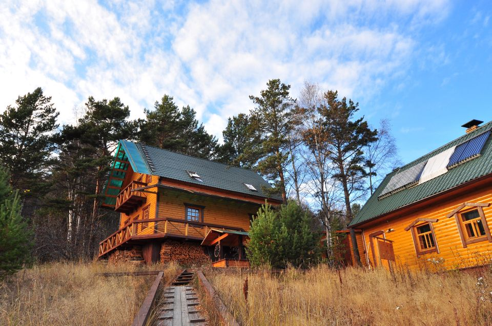 """""""The friendly staff, the tang of new wood in the simply furnished, Siberian log cabin-style dorms, the yoga and chill-out dec"""