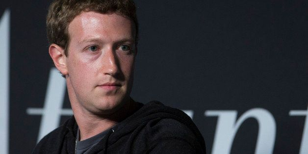 Mark Zuckerberg, founder and chief executive officer of Facebook Inc., listens to an audience member's question during an int
