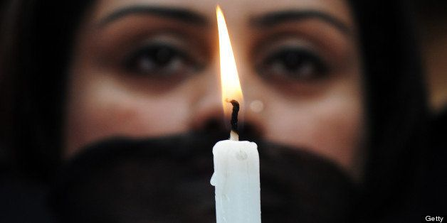 Indian members of a social organisation Our City Our Right holds a candle during a silent protest following the recent gang r