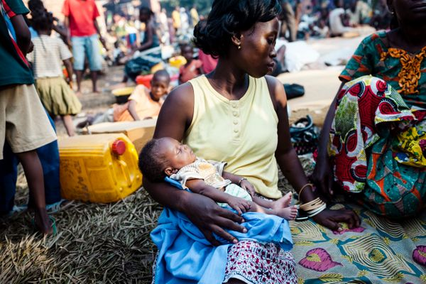 A mother with a three-week old baby in a displacement camp in a monastery in Bangui which houses thousands of IDPs sheltering