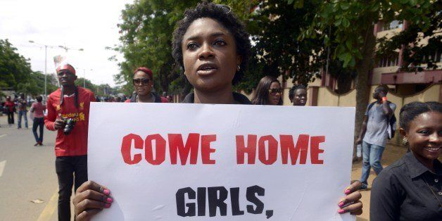 A woman carries placard to press for the release of missing Chibok school girls during a rally by civil society in Lagos on M