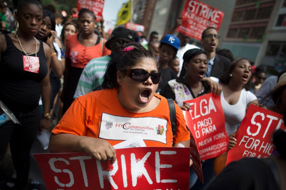 FILE - In this July 29, 2013, file photo, demonstrators in support of fast food workers march towards a McDonald's as they de