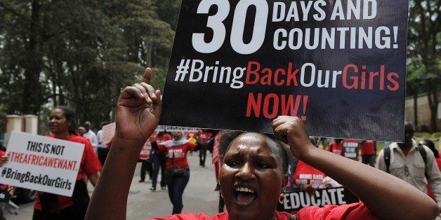 Activists from a coalition of more than 40 African women organisations march on May 15, 2014 in the streets of Kenya's capita
